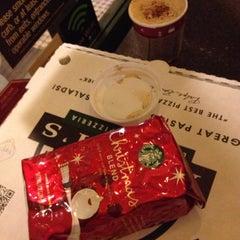 Photo taken at Starbucks by Lindsay W. on 12/9/2012