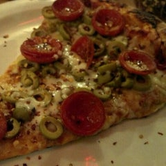 Photo taken at The Roman Candle Pizzeria by Dan S. on 12/11/2012