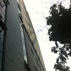 Photo taken at ตึกใหม่ (New Building) by Arthip S. on 7/14/2012