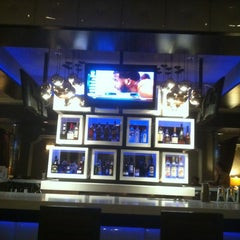 Photo taken at Seven Stars Lounge by Tina B. on 6/24/2012