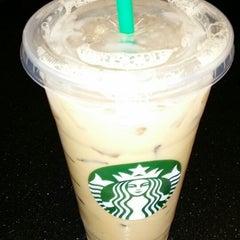 Photo taken at Starbucks by H L. on 3/5/2014