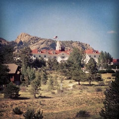 Photo taken at Stanley Hotel by Mariana W. on 7/16/2013