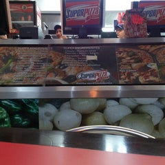 Photo taken at Super Pizza by Charlie B. on 7/26/2014