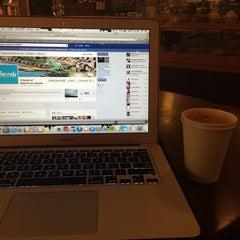 Photo taken at Elliott Bay Café by Jordan W. on 3/26/2014