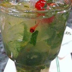 Photo taken at Mojitos Cuban Restaurant by Jorge S. on 1/6/2013
