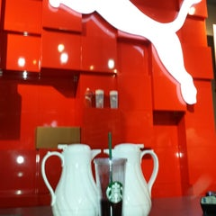 Photo taken at The PUMA Store by Humberto H. on 11/27/2013