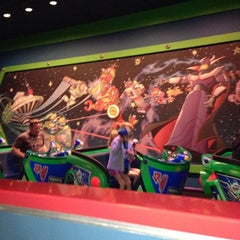 Photo taken at Buzz Lightyear Astro Blasters by Rosie J. on 11/27/2012