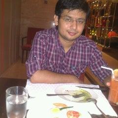 Photo taken at Tangerine by anshul t. on 9/19/2012
