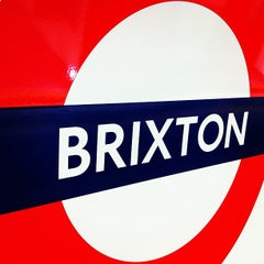 Photo taken at Brixton London Underground Station by Ming Y. on 10/30/2012