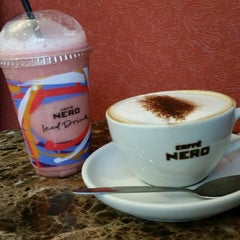 Photo taken at Caffè Nero by Vincent Z. on 6/28/2014