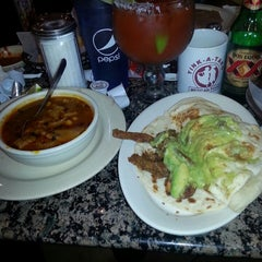 Photo taken at Tink-A-Taco Mexican Food & Cantina by Felicia M. on 4/25/2013
