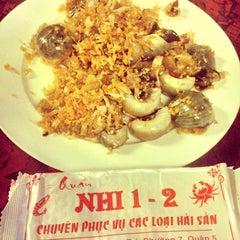 Photo taken at Ốc Nhi by Khoa P. on 1/28/2014