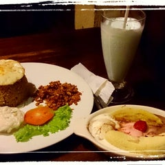 Photo taken at Cafe Asix by fendy on 4/26/2014