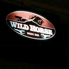 Photo taken at Wild Horse Music Bar by Thiago L. on 9/14/2012