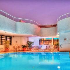 Photo taken at Holiday Inn by Visit Abu Dhabi on 4/25/2013