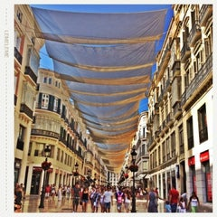 Photo taken at Calle Marqués de Larios by Özlem A. on 7/26/2013