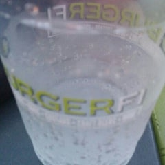 Photo taken at BURGERFI by Adrian G. on 7/27/2015