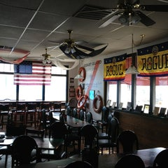 Photo taken at Rogue Ales Bayfront Public House by Mike M. on 4/3/2013