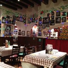 Photo taken at Buca Di Beppo by Ruben P. on 4/26/2012