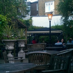 Photo taken at The Spaniards Inn by Ruth V. on 7/28/2012