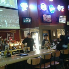 Photo taken at Buffalo Wild Wings Grill & Bar by Alida R. on 9/9/2012