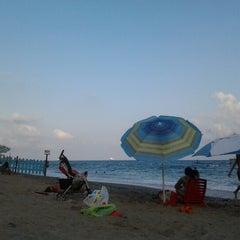 Photo taken at Spiaggia delle Fornaci by Andrea on 8/25/2012