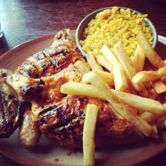Photo taken at Nando's by Amish P. on 6/22/2012
