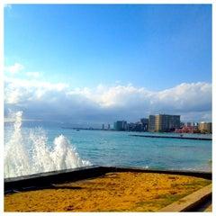 Photo taken at Waikiki Beach Walls by kelli on 3/14/2013