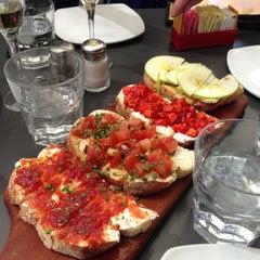 Photo taken at Postino Winecafé by L E. on 4/17/2013