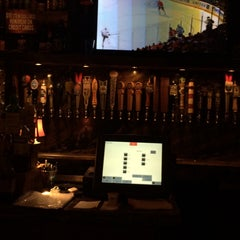 Photo taken at The Lodge Beer and Growler Bar by Neil Travis H. on 6/11/2015