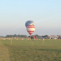 Photo taken at Lincoln Art & Balloon Festival - at Logan County Airport by CJ W. on 8/24/2013