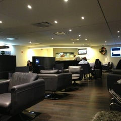 Photo taken at The Centurion Lounge by American Express by Isaac D. on 12/24/2012