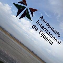 Photo taken at Aeropuerto Internacional de Tijuana (TIJ) by Kat D. on 7/5/2013