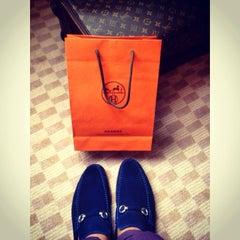 Photo taken at Hermès by Ryan on 8/11/2014
