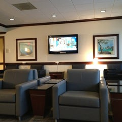 Photo taken at Admirals Club by Amber S. on 6/26/2013
