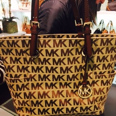 Photo taken at Michael Kors by LILIANA R. on 1/30/2015