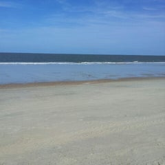 Photo taken at Tybee Curve Beach by Travis P. on 5/28/2013