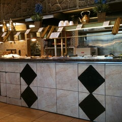 Photo taken at Dimassi's Mediterranean Buffet by Rachel M. on 12/17/2011