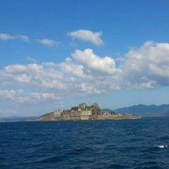 Photo taken at 端島 (軍艦島) Hashima (Gunkanjima) Island by May C. on 10/2/2012