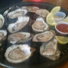 Photo taken at Scuttlebutt's Seafood Bar & Grill by justin s. on 5/4/2015