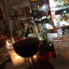 Photo taken at Cru Wine Bar by Kristin W. on 12/30/2015