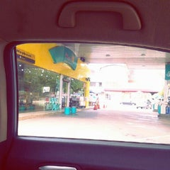 Photo taken at Petronas by Nana P. on 9/9/2013