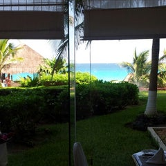 Photo taken at Café Quetzal by Lina M. on 10/18/2012
