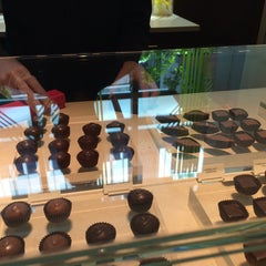 Photo taken at Fran's Chocolates by Victoria L. on 5/10/2015