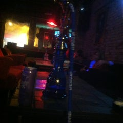 Photo taken at Eastown Hookah Lounge by Neal M. on 10/28/2012