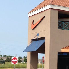 Photo taken at Nike Outlet by Kevin B. on 7/31/2014