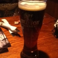 Photo taken at Fox and Hound Smokehouse and Tavern by Ted S. on 2/23/2013