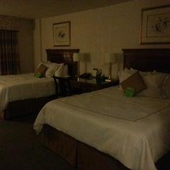 Photo taken at Savoy Suites Hotel by Da Eun L. on 12/8/2012