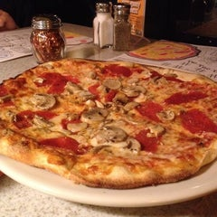 Photo taken at Brixx Wood Fired Pizza by Lisa S. on 9/4/2014