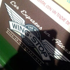 Photo taken at Wingstop by Edmundo G. on 3/22/2013